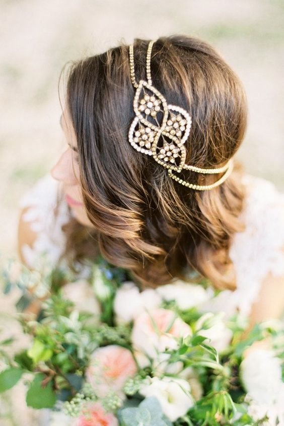 a gold and crystal boho chic bridal headpiece with two layers looks very bold and romantic