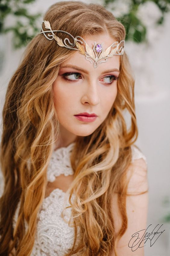 a gold and silver Elven tiara with a purple rhinestone in the center is a chic and beautiful idea