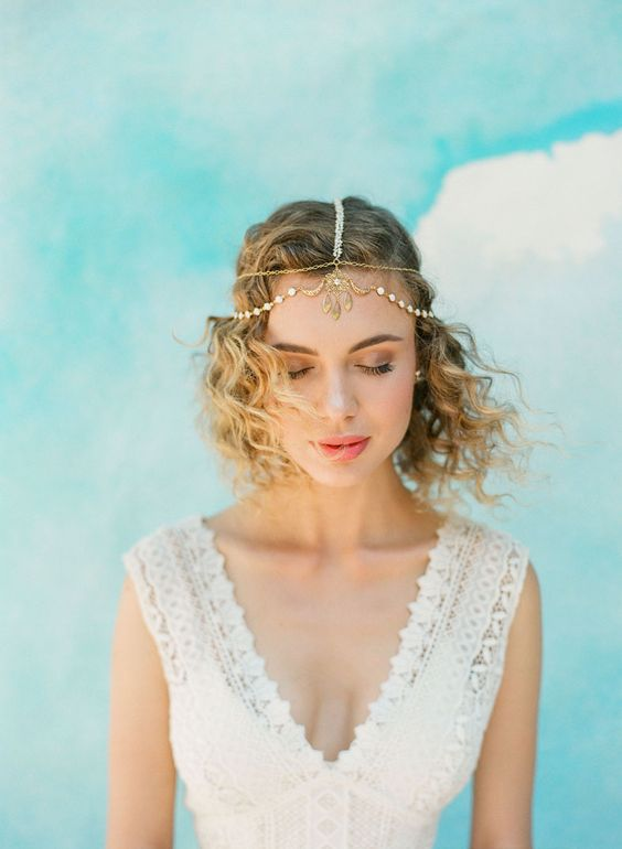 a gold chain and rhinestone headpiece will give a slight Moroccan feel to your boho chic bridal look