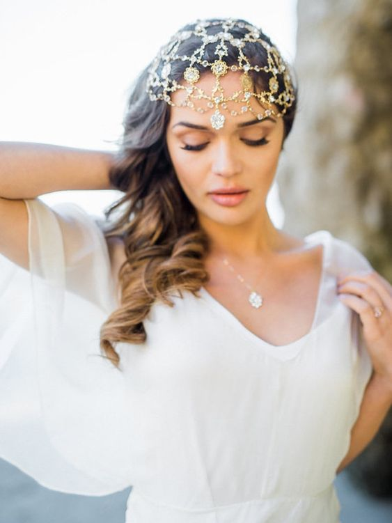 a gold chain headpiece wiht lots of pendants is a great fit for a Moroccan boho bride