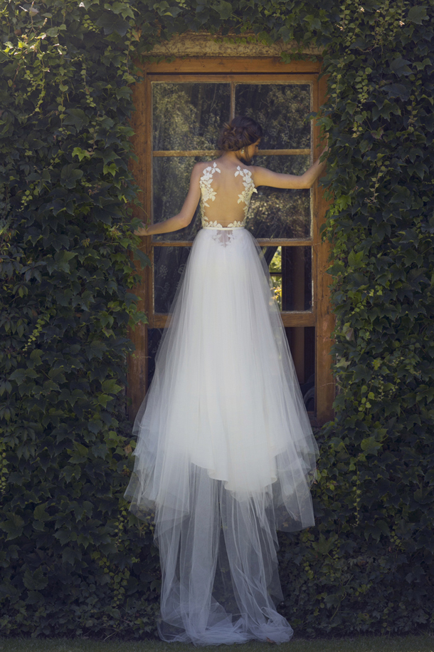 a gorgeous A-line wedding dress of leaf appliques, a tulle A-line skirt with a train and an illusion back with leaf appliques is wow