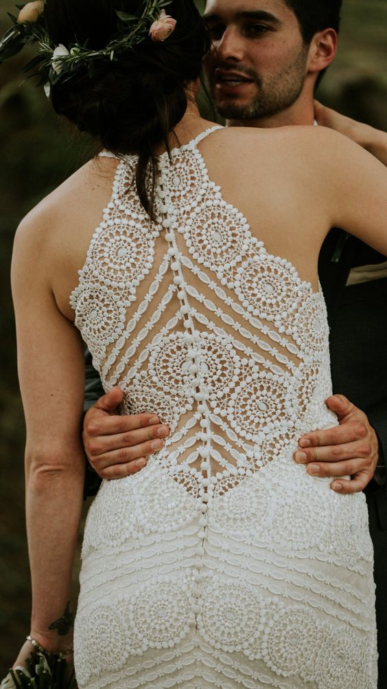 a gorgeous boho lace fitting wedding dress with an illusion racer back done with only leace and pearls is a fantastic idea