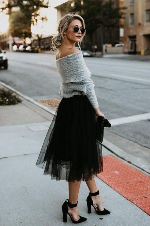 a grey off the shoulder sweater, a black tulle midi, black ankle strap heels for a fall or winter wedding