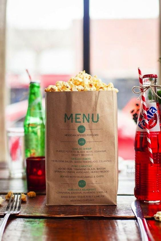 a menu printed out on a paper bag with popcorn is great for a non-formal wedding