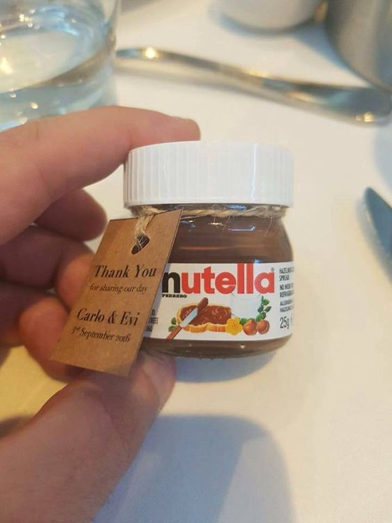 a mini jar with Nutella with tags is a great and delicious idea of a summer wedding favor