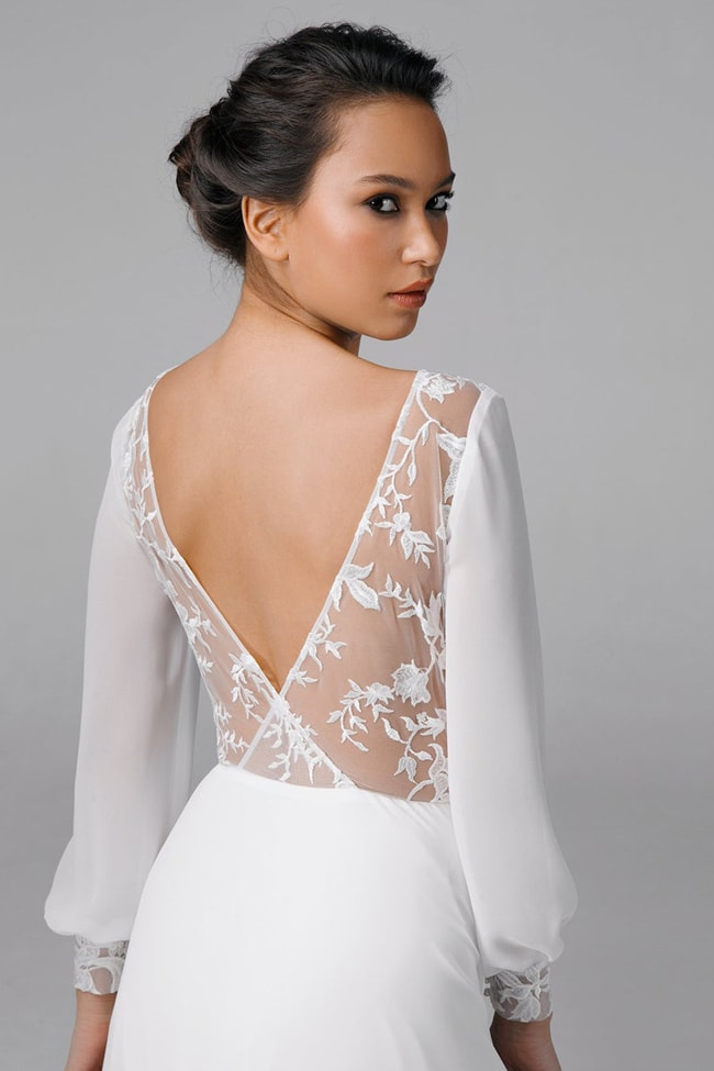 a modern plain A-line wedding dress with chic sleeves, a beautiful cutotu back with lace covering it partly is amazing