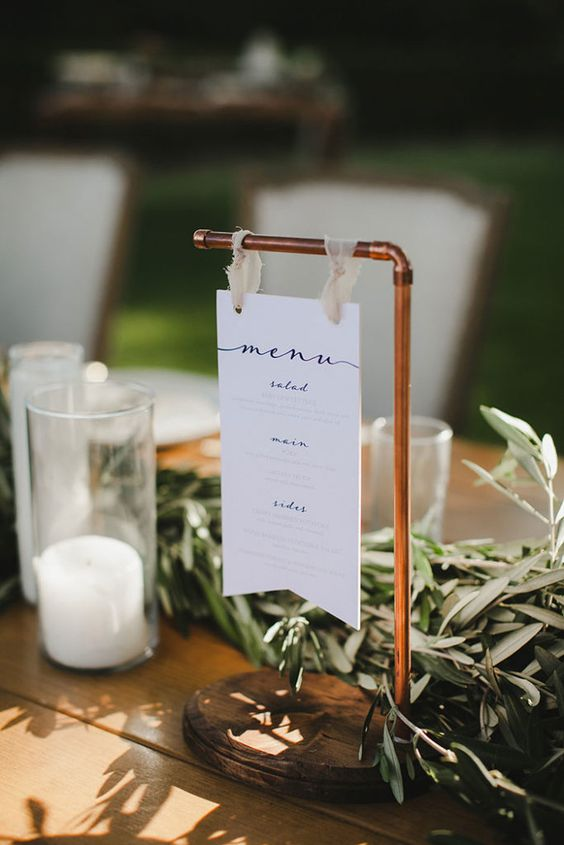 a modern wedding menu hanging on copper is a stylish idea for a modern or boho wedding