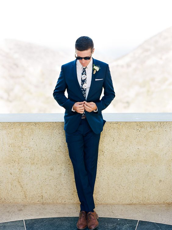 a navy suit, a moody floral tie and brown shoes for an ultimate groom's look with trends incorporated