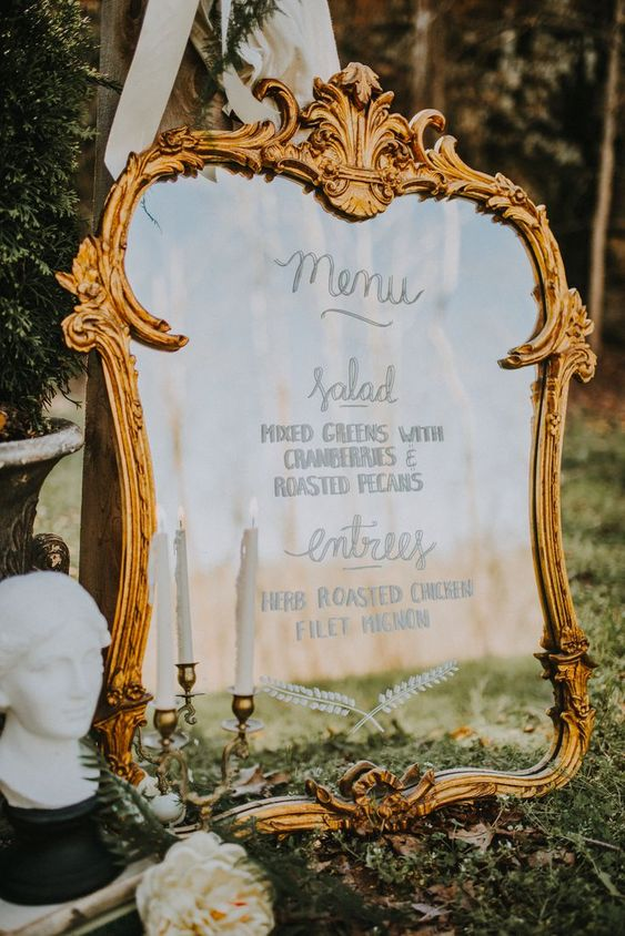 a refined mirror in a chic frame is a stylish and gorgeous idea for a more formal or fairy-tale wedding