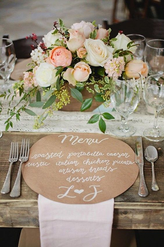 a round kraft paper menu with white letters is a cool idea to add a rustic feel to the table
