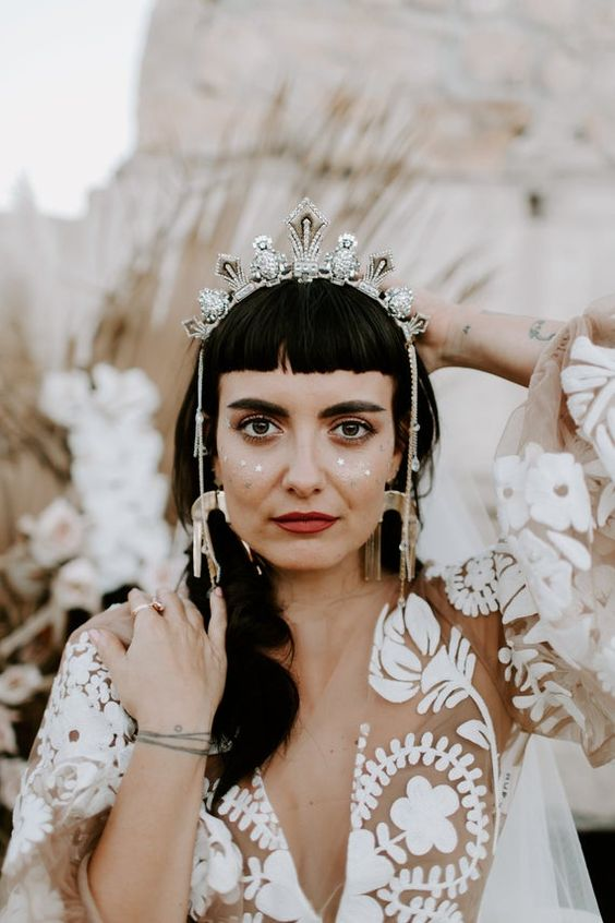a silver and rhinestone bridal crown with hanging crystals is a very boho chic idea