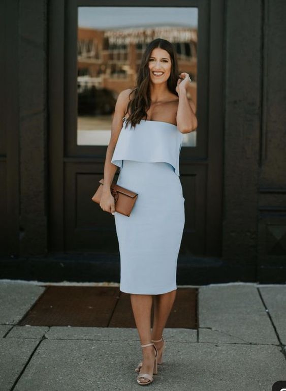 a strapless pale blue midi fitting dress, nude heels and a brown clutch for a summer or spring wedding