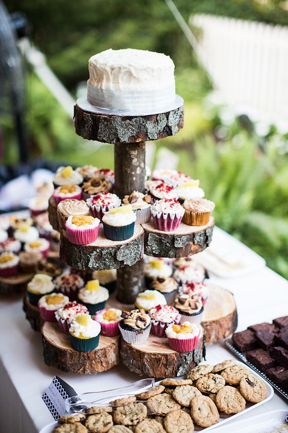 a tiered wedding cake stand of wood slices and a stick is a stylish idea for a rustic or a woodland wedding