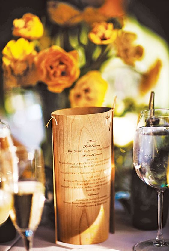 a wedding menu of bark is a stylish idea and you may wrap a vase with it