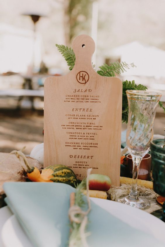 a wood burnt cutting board is a cool idea for a farm to table wedding or for a rustic one
