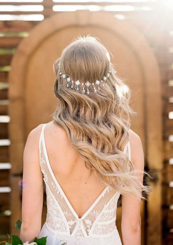 an chic rhinestone and crystal boho wedding headpiece is like a halo with vintage elegance