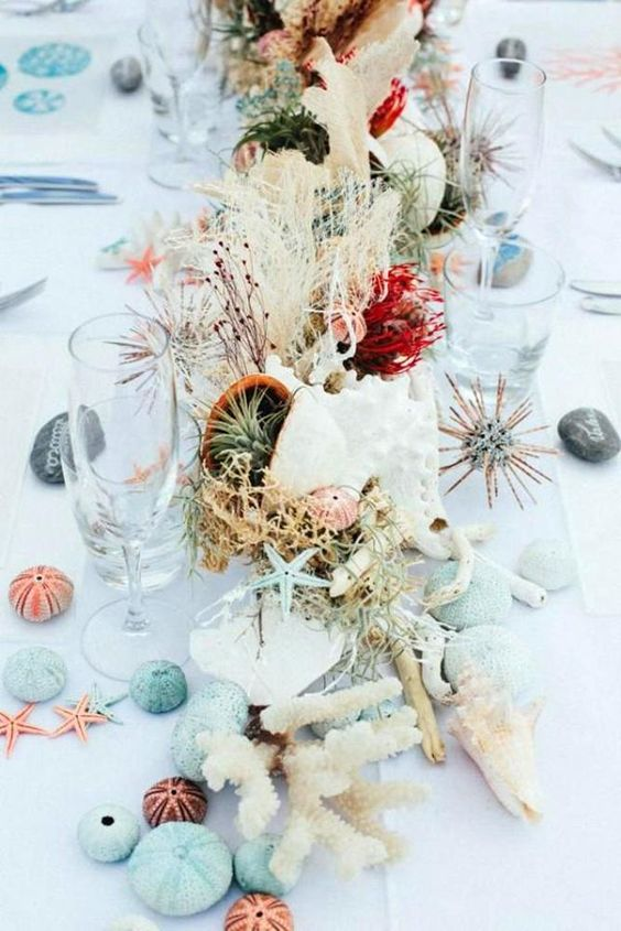 bright beach wedding table decor with air plants, urchins, seashells, blooms, corals and herbs is chic