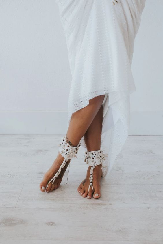 catchy macrame and seashell barefoot wedding sandals are amazing for a boho beach bride