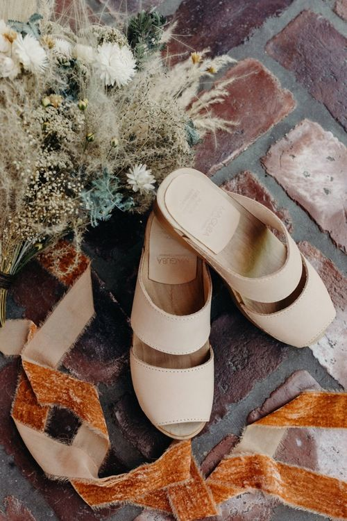 comfortable neutral flat sandals will be a nice idea for a beach bride or bridesmaid