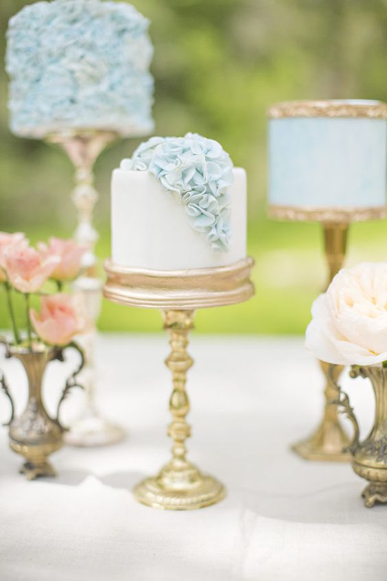 elegant gilded gold cake stands make the ruffled and hydrangea wedding cakes more refined