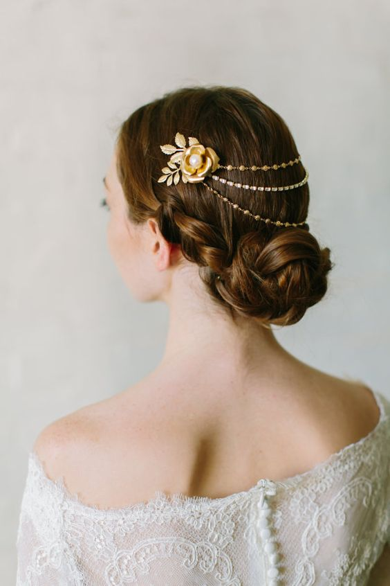 gold and silver chain and crystal bridal headpiece with a faux flower with a pearl plus fabric leaves looks veyr elegant