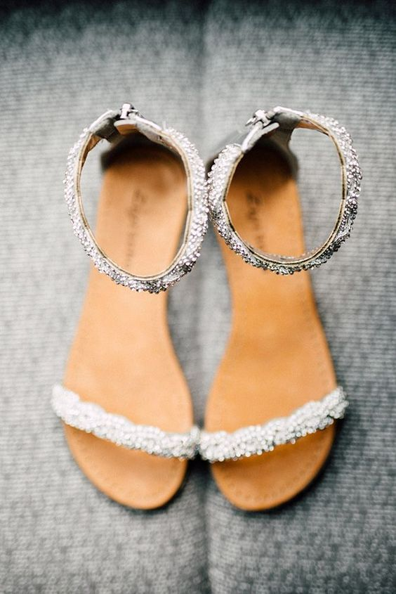 heavily embellished ankle strap wedding sandals are nice for adding a shiny touch to the look