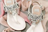 heavily embellished flat wedding sandals look chic, bright, shiny and bold and will be a nice option