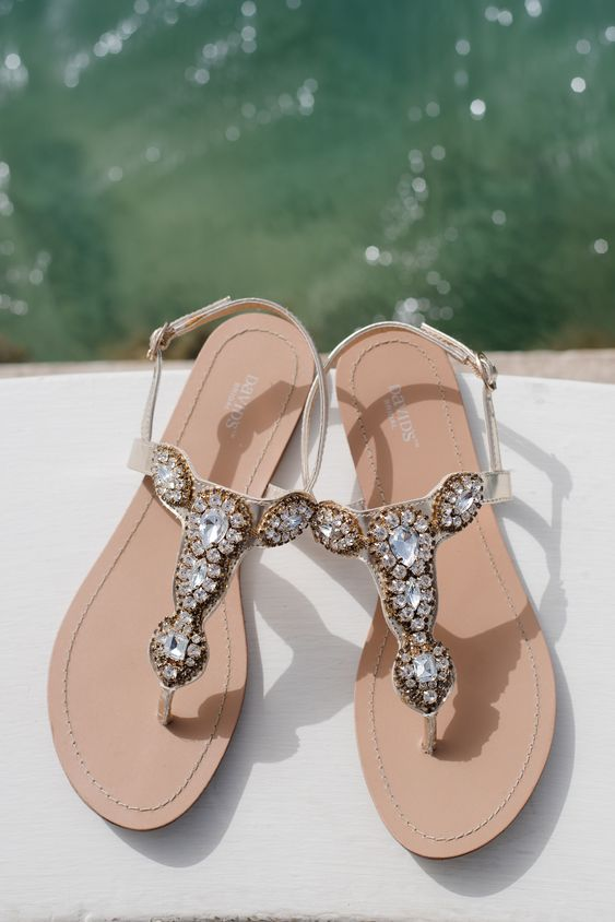 heavily embellished gold flat wedding sandals are amazing for a destination beach wedding
