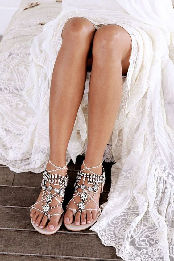 heavily embellished lace up wedding sandals will finish off your boho beach bridal look perfectly