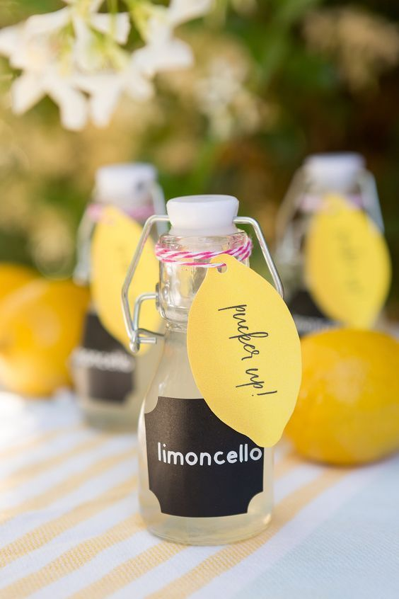 mini bottles with limoncello with colorful tags are a cute idea for a summer or Italian wedding
