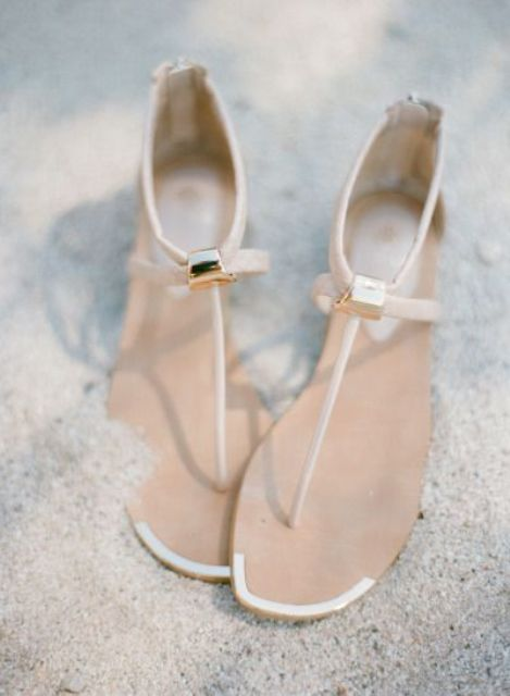 minimalist flat sandals with slight gold touches look chic and stylish and can be worn after the wedding