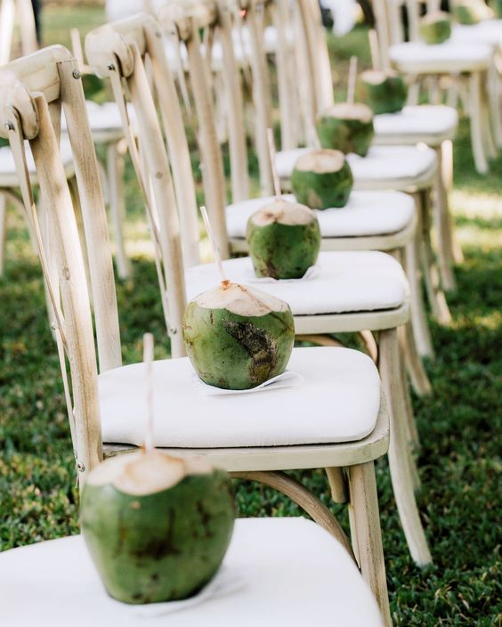 place fresh coconut water on each chair to keep your guests refreshed and they will be totally happy