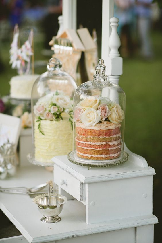 place your wedding cakes into cloches to keep them safe from any bugs outdoors and highlight them