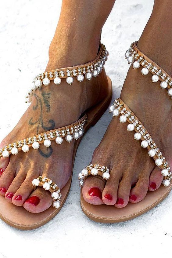 strappy lace up embellished and pearl flat sandals look chic and bold and will add a touch of glam