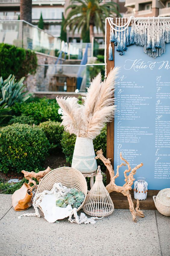 stunning beach decor in boho style, with pampas grass, succulents, driftwood, woven touches and candles
