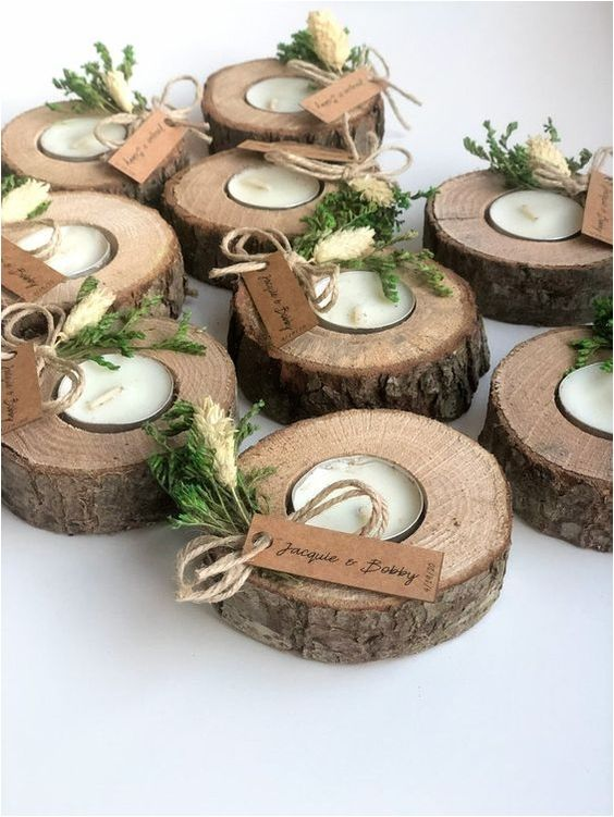 wood slice candle holders with tealights, greenery, tags are nice for a summer wedding, camp, woodland or rustic