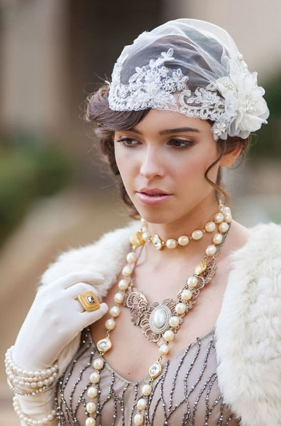 a Juliet cap veil with embellishments and a fabric bloom with pearls is a gorgeous and refined idea to rock