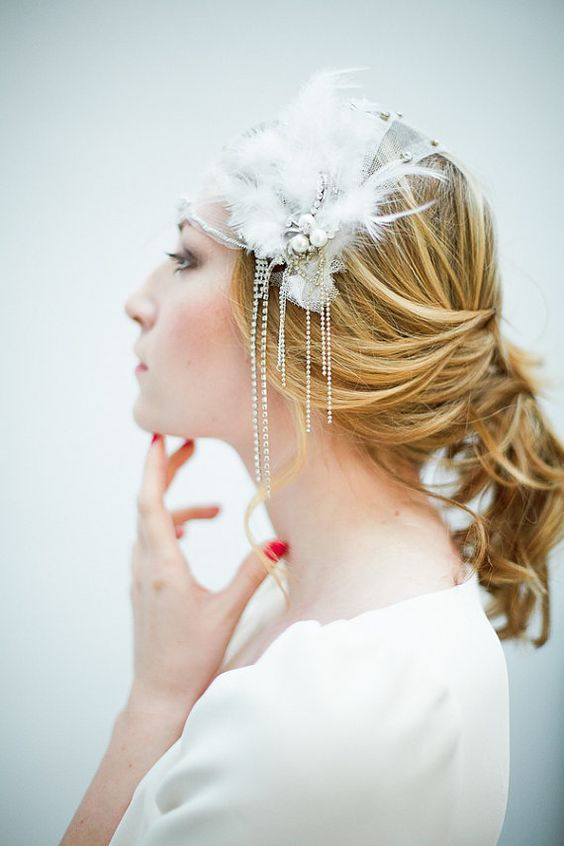 a breathtaking bridal headpiece with feathers, crystals and pearls is a very cool idea, pair it with a cap veil
