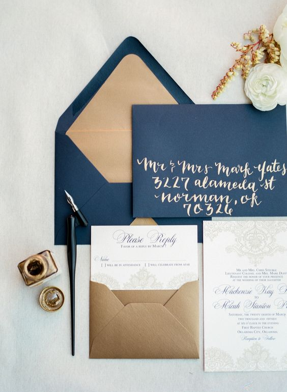 a chic navy and gold weddding invitation suite with calligraphy