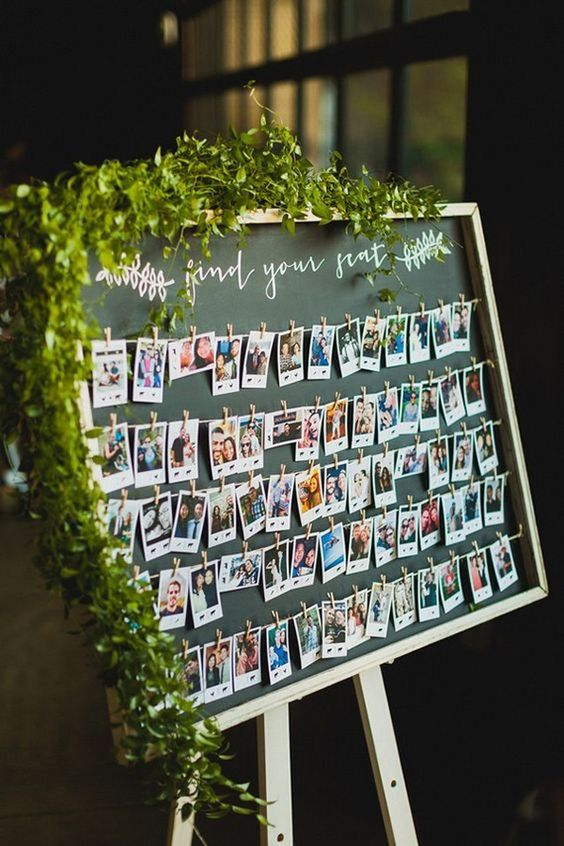 an unique wedding seating chart with polaroids but modern look