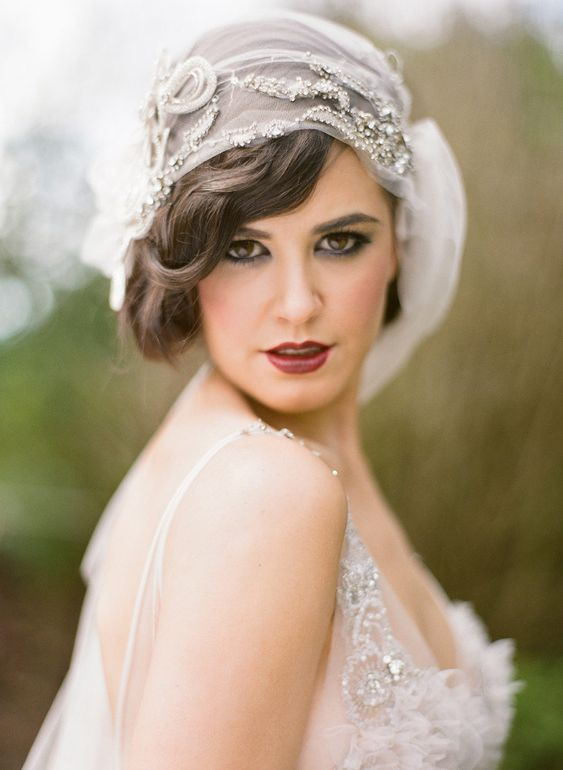 a fantastic embellished cap veil with a fabric bloom is a beautiful idea for an art deco bride