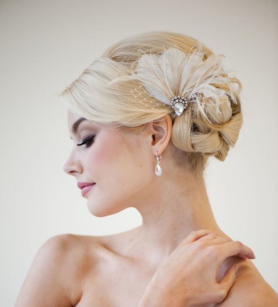 a fantastic embellished feather hairpiece with a small veil touch is amazing for a 20s bride