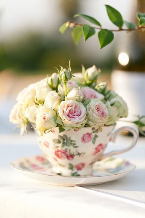 a floral vintage teacup with fresh pink blooms is a gorgeous wedding favor and escort card holder