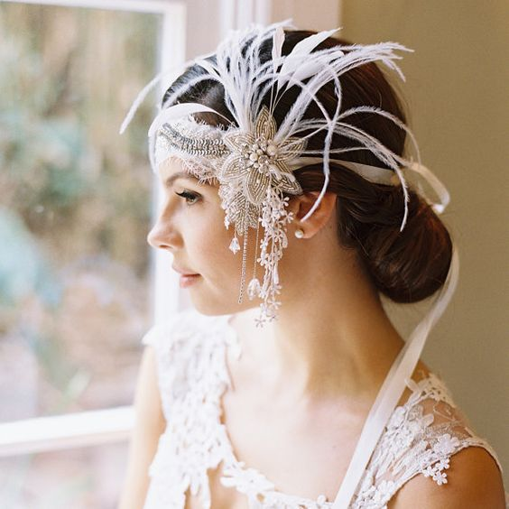 a jaw-dropping art deco wedding headpiece with embellishments, pearls, feathers and hanging flowers