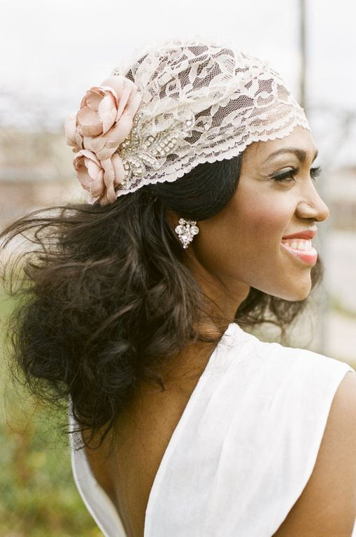 a lace cap veil with embellishments and pink fabric blooms for a lovely 20s inspired look