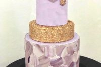 a purple and gold wedding cake with a glitter tier, a purple marble hexagon tier and a sleek one decorated with gold hexagons