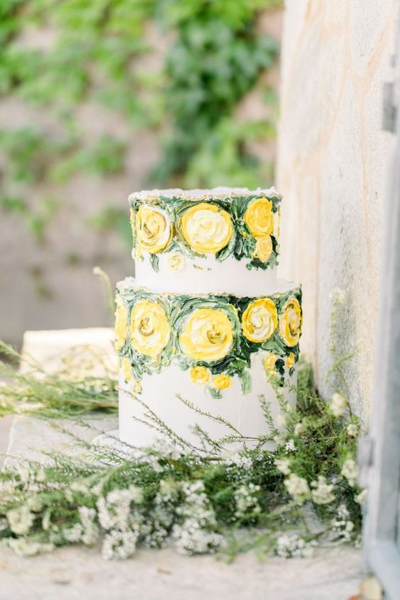 a refined and artistic wedding cake with painted yellow blooms and greenery for a spring or summer wedding