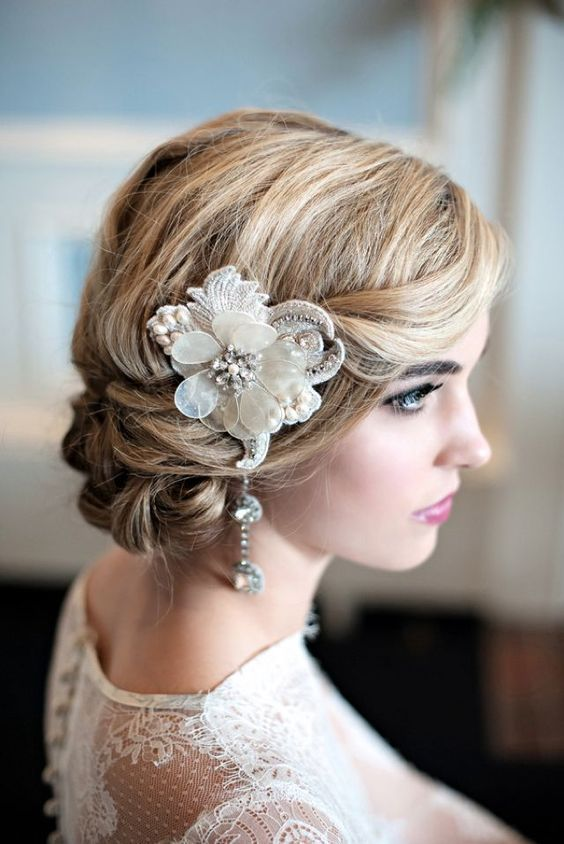 a refined embellished flower headpiece with a hanging crystal detail is a very gorgeous idea for a 20s bride