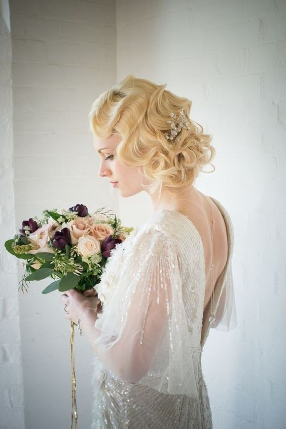a small yet elegant embellished headpiece to pair with an embellished dress and a back necklace is wow