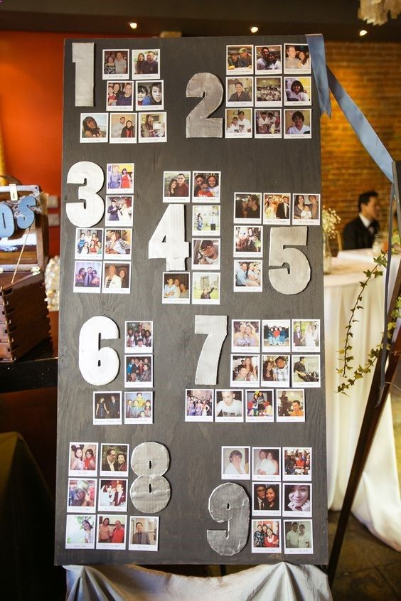 a stylish and simple wedding seating chart with large numbers and your guests' Polaroids